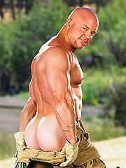 Naked bald dude with huge muscles