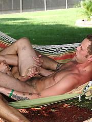 Two hot guys in outdoor love scene