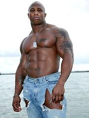 Ebony bodybuilder outdoors