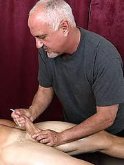 Bronzed surfer Christian Kennedy in massage session from older Jake