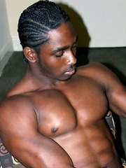 Well-muscled black hung jerks off