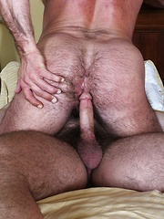 Brad Kalvo fucks Mike Dozer doggystyle on the bed with his cock suffocating on a rubber