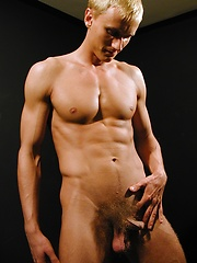 Ripped stud Michael Davids plays with this uncut dick.